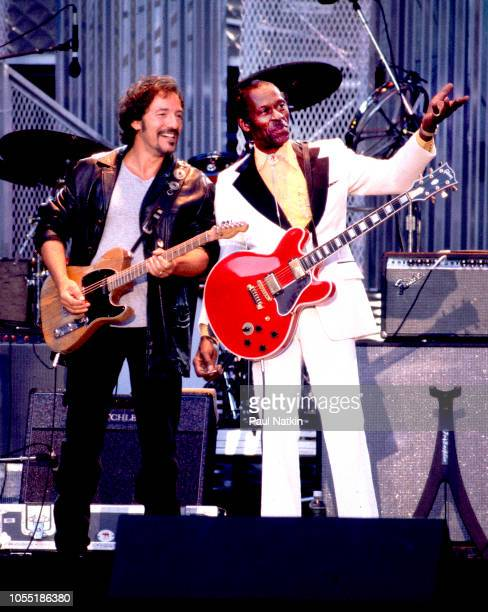 Bruce Springsteen left and Chuck Berry performing onstage at the opening of the Rock and Roll Hall of Fame at Browns Stadium Cleveland Ohio September...