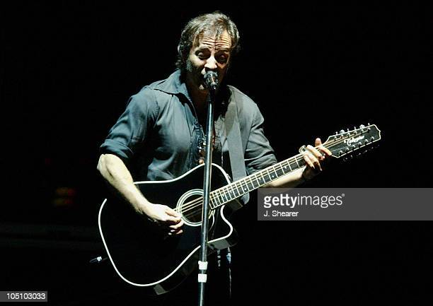 Bruce Springsteen of the E Street Band performs a solo acoustic version of Born in the USA