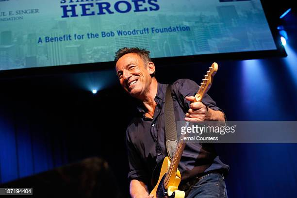 """Bruce Springsteen performs at the 7th annual """"Stand Up For Heroes"""" event at Madison Square Garden on November 6, 2013 in New York City."""