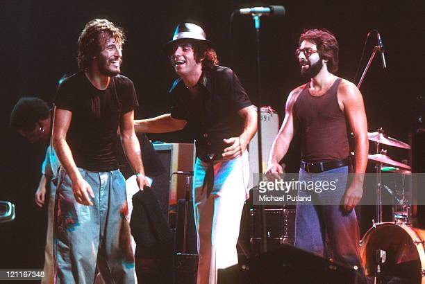 Bruce Springsteen performs on stage with Steven Van Zandt and Max Weinberg of the E Street Band at the Hammersmith Odeon in London England on...