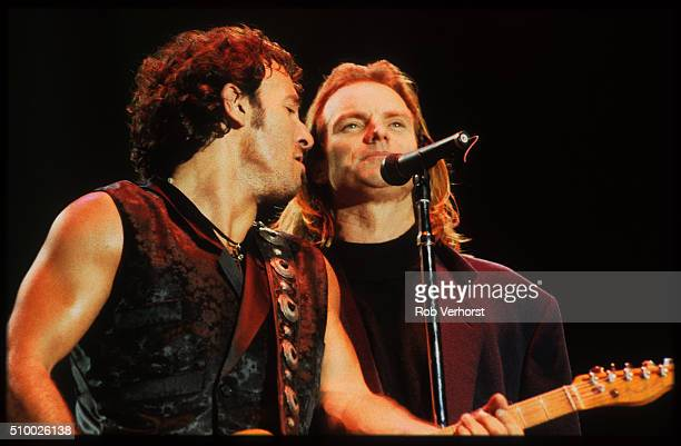 Bruce Springsteen performs on stage with Sting at an Amnesty International concert at Wembley Stadium London 2nd September 1988