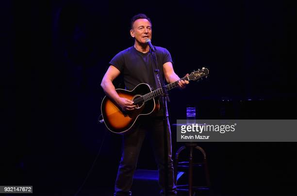 Bruce Springsteen performs onstage during a special performance of Springsteen on Broadway in front of an audience of SiriusXM subscribers at Walter...