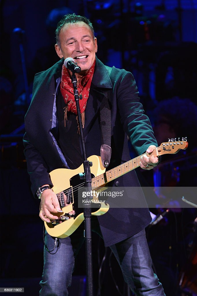 Bruce Springsteen performs onstage during The Revlon Concert for the Rainforest Fund, 'Baby It's Cold Outside' at Carnegie Hall on December 14, 2016 in New York City.