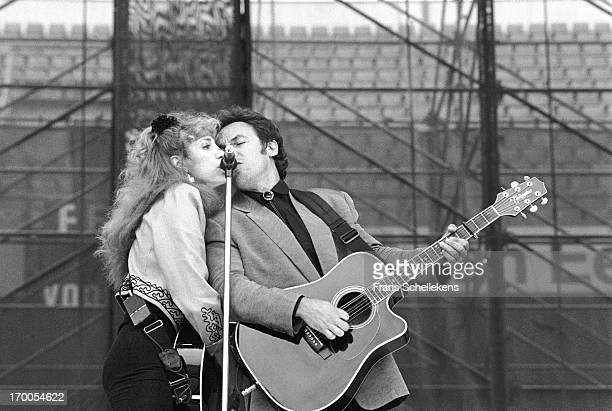 Bruce Springsteen performs with his wife Patti Scialfa at the Feijenoord Stadium in Rotterdam the Netherlands during the Tunnel Of Love tour on 28th...