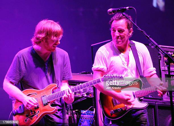 Bruce Springsteen performs with Trey Anastasio of Phish on stage during Bonnaroo 2009 on June 14, 2009 in Manchester, Tennessee.