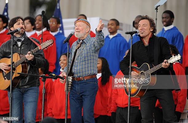 Bruce Springsteen Pete Seeger and Seeger's grandson Tao Seeger perform at the 'We Are One' concert one of the events of US presidentelect Barack...