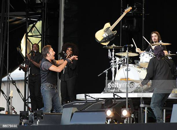 Bruce Springsteen throws away his guitar while performing live with the E Street Band on day one of the 40th Pinkpop Festival at Megaland on May 30...