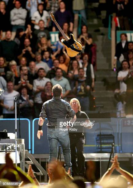 Bruce Springsteen throws his guitar during his performance onstage at Madison Square Garden on November 7 2009 in New York City