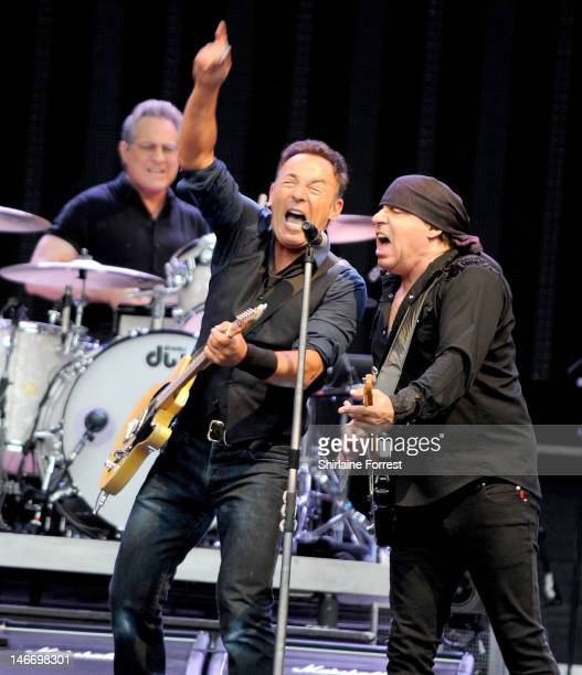 Bruce Springsteen with Max Weinberg and Steven Van Zandt of the E Street Band perform at Etihad Stadium on June 22 2012 in Manchester England