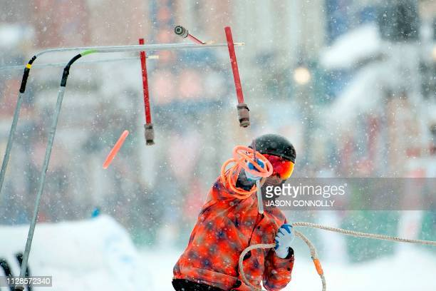 Bruce Stott of Frisco Colorado spears rings with his baton during the 71st annual Leadville Ski Joring weekend competition under the snow on March 3...
