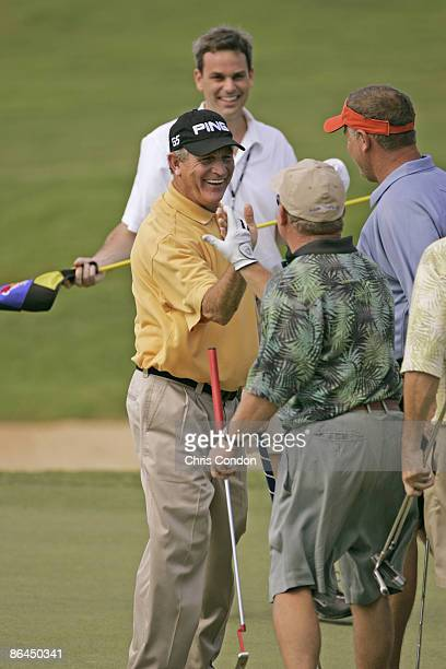 Bruce Summerhays celebrates a birdie on with Pat Finley during the Thursday ProAm at the 2006 Mastercard Championship at Hualalai resort Kona Hawaii