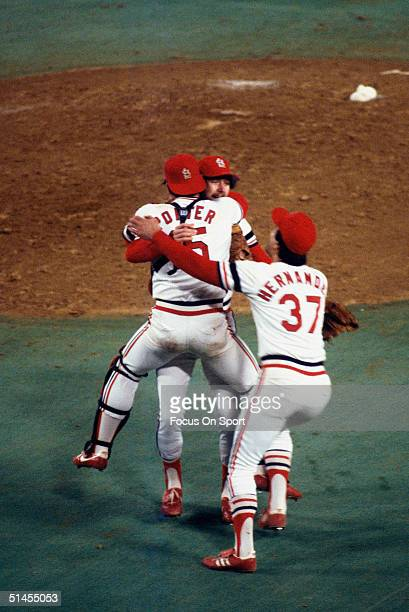 Bruce Sutter Darrell Porter and Keith Hernandez of the St Louis Cardinals run to the mound to celebrate winning the World Series against the...