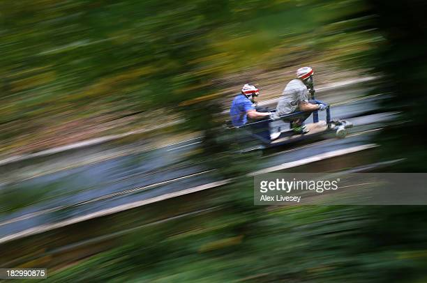 Bruce Tasker and Stuart Benson of the Great Britain bobsleigh squad ride a push cart down the bobsleigh push track at Bath University on September 20...