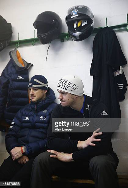 Bruce Tasker and Stuart Benson of the Great Britain bobsleigh team wait in the athletes changing room prior to a practice session at the Viessmann...