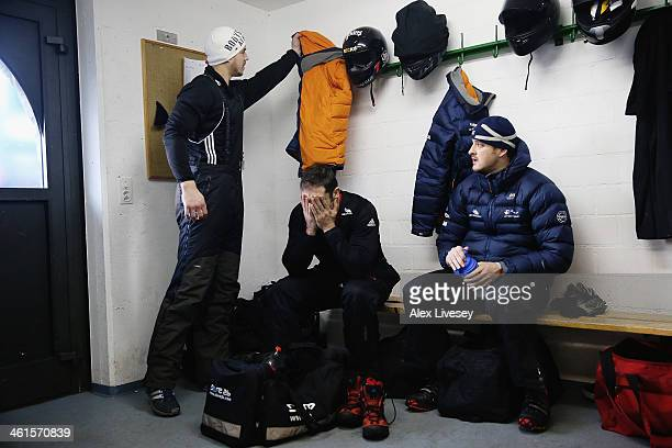 Bruce Tasker John Jackson and Stuart Benson of the Great Britain bobsleigh team get ready in the athletes changing room prior to a practice session...
