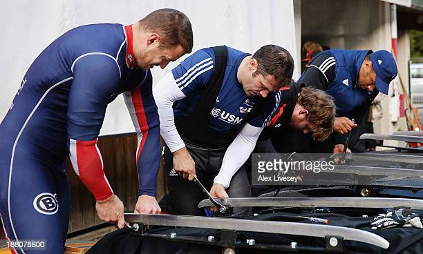 Bruce Tasker John Jackson Ben Simons and Henry Nwume of the Great Britain bobsleigh team prepare their bobsleigh runners prior to a training session...