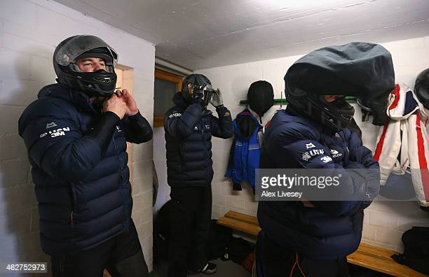 Bruce Tasker Stuart Benson and John Jackson of the Great Britain bobsleigh team prepare to walk out for heat one of the four man bobsleigh...