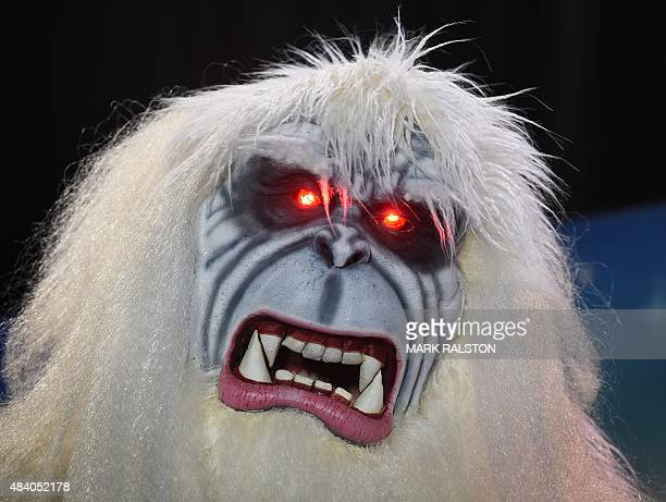Bruce the Yeti celebrates after winning a costume competition at the Disney D23 EXPO 2015 held at the Anaheim Convention Center in Anaheim California...