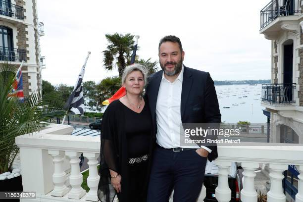 Bruce Toussaint and Catherine Toussaint attend the Grand Hotel Barrière Dinard Opening on June 15, 2019 in Dinard, France.