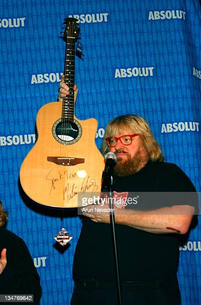 Bruce Vilanch auctioning a guitar signed by Melissa Etheridge