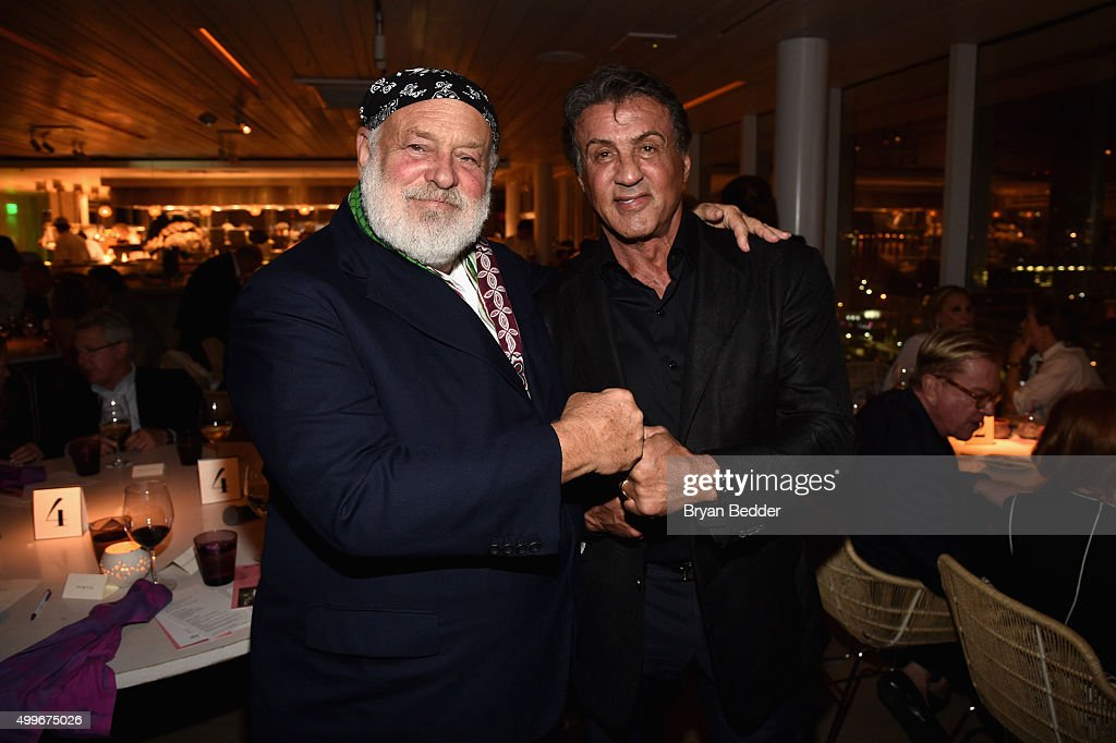 Bruce Weber and Sylvester Stallone attend the Vanity Fair And NSU Art Museum's Private Dinner Hosted By Bob Colacello And Bonnie Clearwater In Honor Of Douglas S. Cramer at Juvia on December 2, 2015 in Miami Beach, Florida.