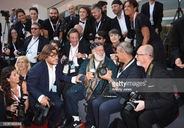 Bruce Weber with the red carpet photographers ahead of the 'My Brilliant Friend ' screening during the 75th Venice Film Festival at Sala Grande on...
