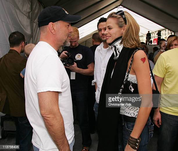 Bruce Willis and Brooke Burns during Sony Computer Entertainment America and the Bruce Willis Foundation Present Playstation BANDtogether Inside at...