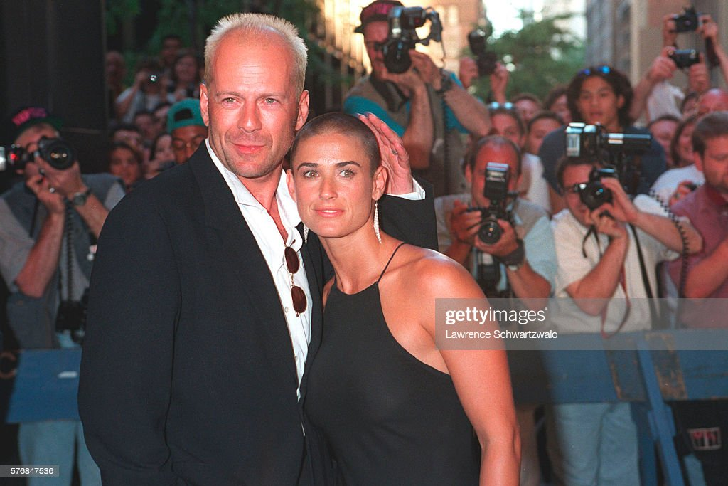Bruce Willis and Demi Moore Posing for Photographers : News Photo