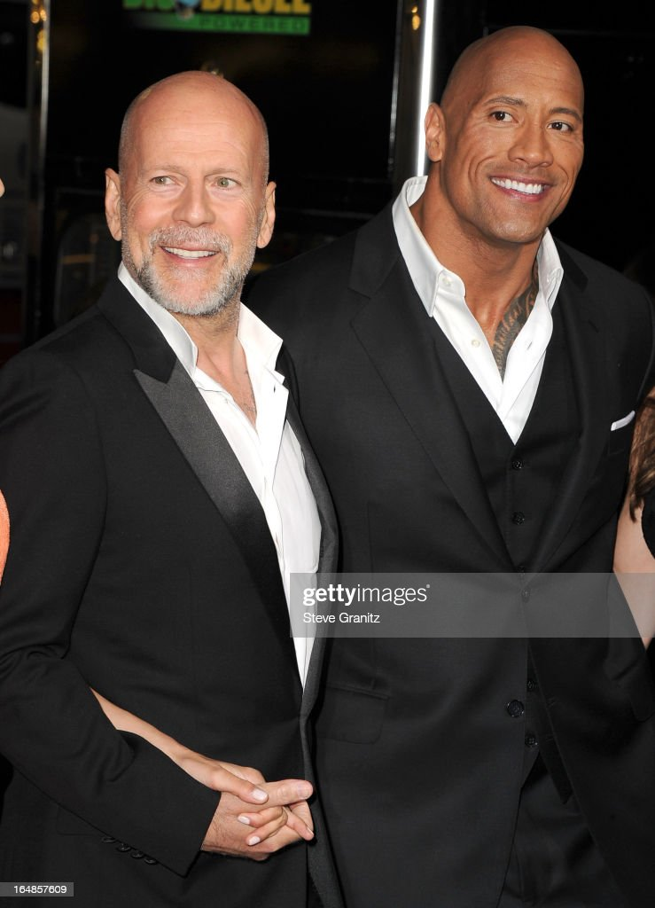 Bruce Willis and Dwayne Johnson arrives at the 'G.I. Joe: Retaliation' - Los Angeles Premiere at TCL Chinese Theatre on March 28, 2013 in Hollywood, California.