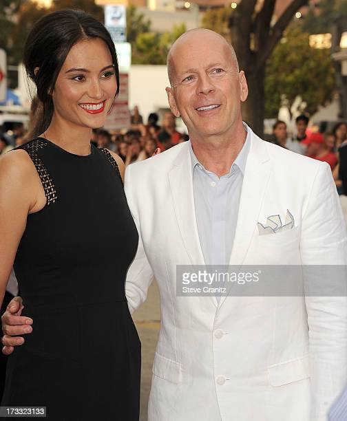 Bruce Willis and Emma Heming arrives at the 'RED 2' Los Angeles Premiere at Westwood Village on July 11 2013 in Los Angeles California