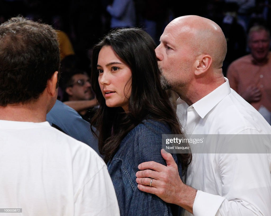 Bruce Willis (R) and Emma Heming attend Game Two of the Western Conference Finals between the Phoenix Suns and the Los Angeles Lakers during the 2010 NBA Playoffs at Staples Center on May 19, 2010 in Los Angeles, California.