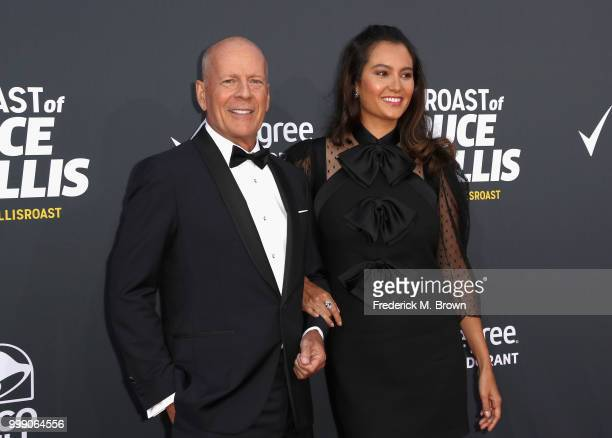 Bruce Willis and Emma Heming attend the Comedy Central Roast of Bruce Willis at Hollywood Palladium on July 14, 2018 in Los Angeles, California.