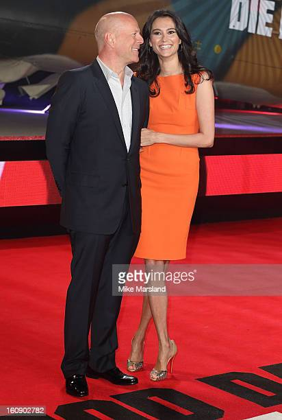 Bruce Willis and Emma Heming attend the UK premiere of A Good Day To Die Hard at Empire Leicester Square on February 7 2013 in London England