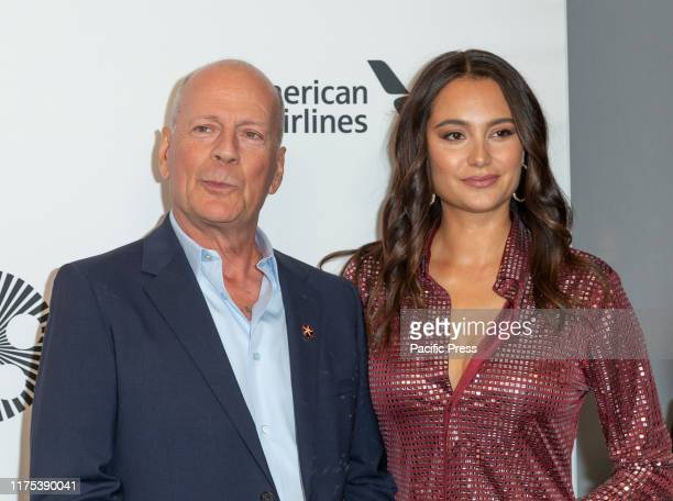 Bruce Willis and Emma Heming Willis wearing dress by Bottega Veneta attend Motherless Brooklyn premiere during 57th New York Film Festival at Alice...