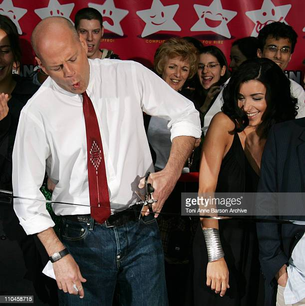 Bruce Willis and Jenifer Bartoli during 'La Fete du Cinema' Ribbon cutting Ceremony Photocall at UGC Cine Cite Bercy in Paris France