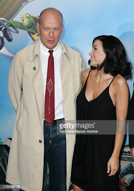 Bruce Willis and Jenifer Bartoli during Over The Hedge Paris Premiere / Nos Voisins Les Hommes Premiere at UGC Cine Cite Bercy in Paris France