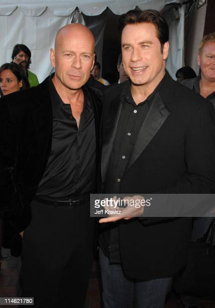 Bruce Willis and John Travolta during 2007 MTV Movie Awards Backstage and Audience at Gibson Amphitheater in Los Angeles California United States