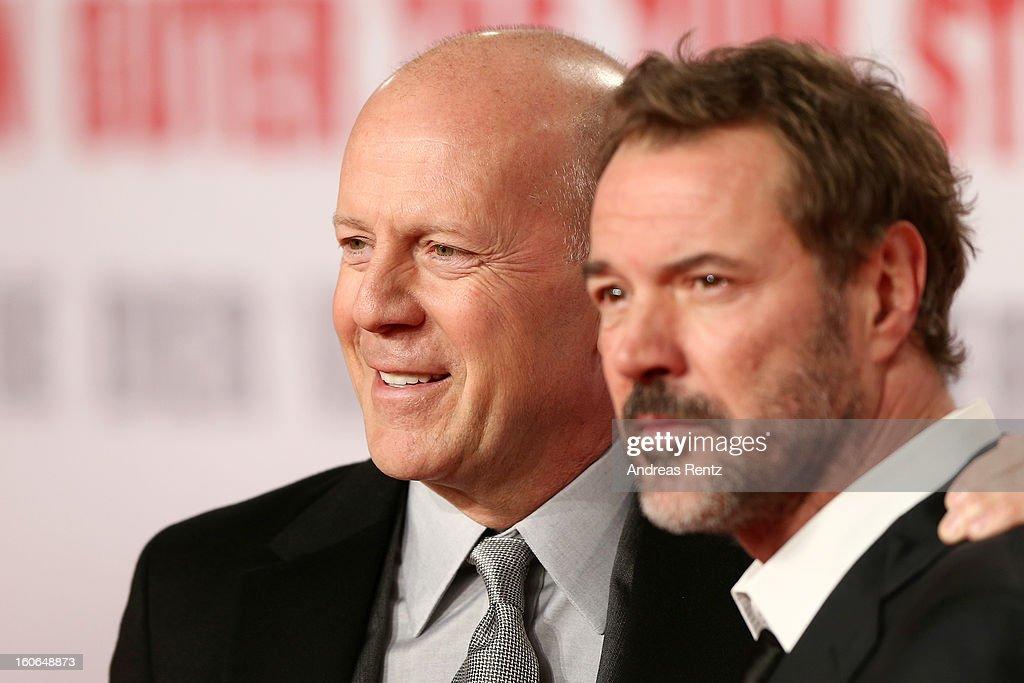 Bruce Willis and Sebastian Koch attend 'Die Hard - Ein Guter Tag Zum Sterben' Germany Premiere at Cinestar Potsdamer Platz on February 4, 2013 in Berlin, Germany.