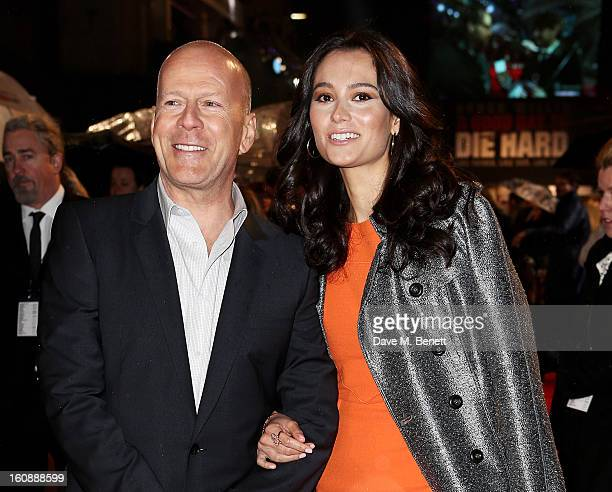 Bruce Willis and wife Emma Heming attend the UK Premiere of 'A Good Day To Die Hard' at Empire Leicester Square on February 7 2013 in London England