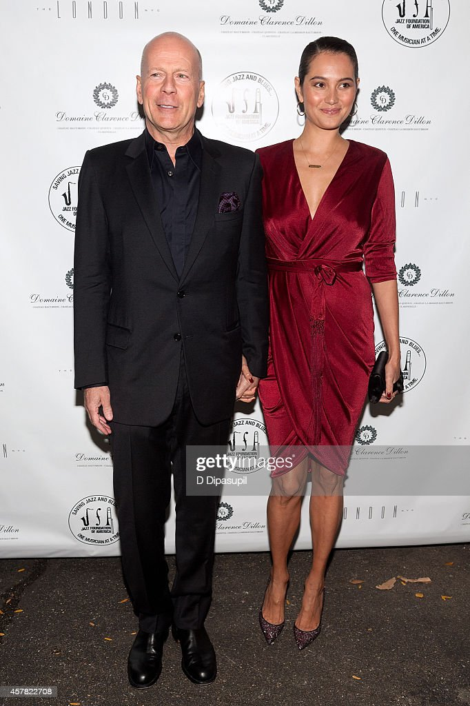 Bruce Willis (L) and wife Emma Heming-Willis attend The Jazz Foundation Of America's 13th Annual 'A Great Night In Harlem' Gala Concert at The Apollo Theater on October 24, 2014 in New York City.