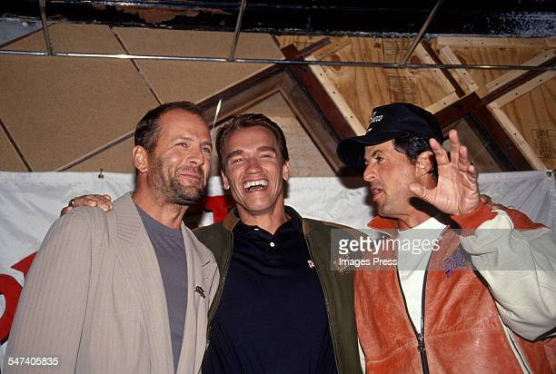 Bruce Willis, Arnold Schwarzenegger and Sylvester Stallone attend the Grand Opening of Planet Hollywood on October 22, 1991 in New York City.