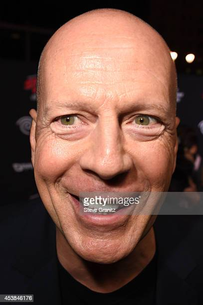 Bruce Willis arrives at the 'Sin City A Dame To Kill For' Los Angeles Premiere at TCL Chinese Theatre on August 19 2014 in Hollywood California