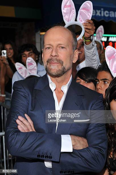 Bruce Willis arrives on the red carpet of Sony Pictures' premiere of 'House Bunny' at the Mann Village Theatre on August 14 2008 in Westwood...