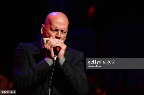 Bruce Willis performs onstage during Love Rocks NYC A Change is Gonna Come Celebrating Songs of Peace Love and Hope A Benefit Concert for God's Love...