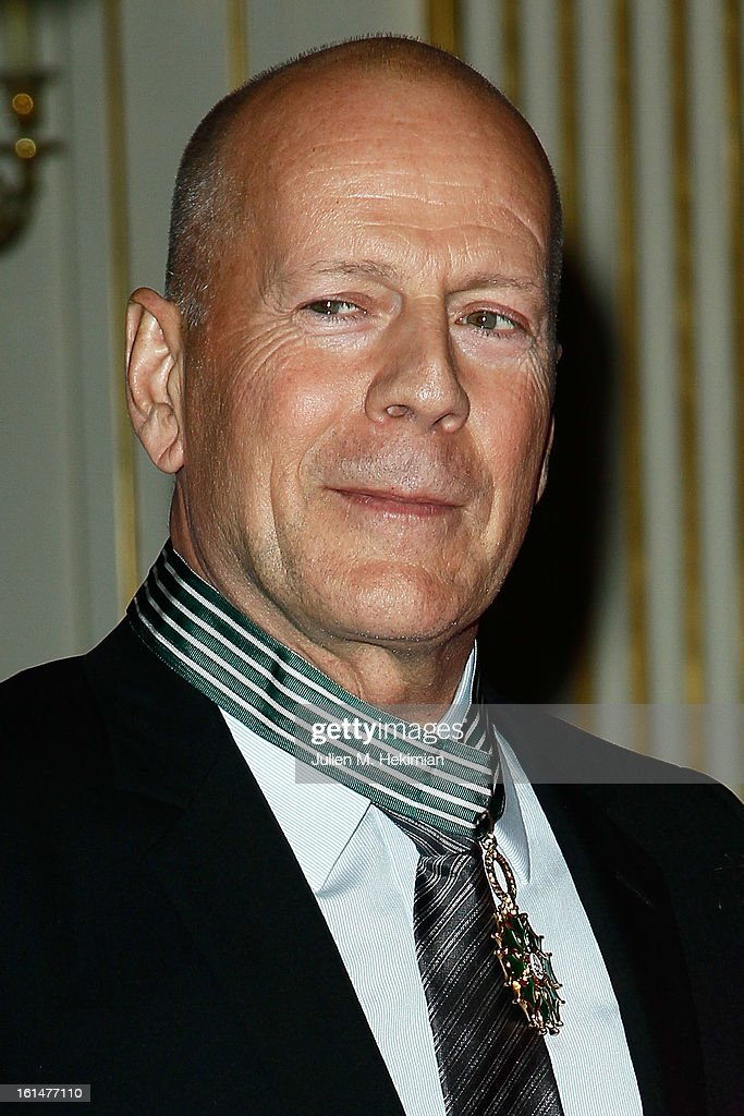 Bruce Willis poses after being awarded Commandeur dans l'Ordre des Arts et Lettres at Ministere de la Culture on February 11, 2013 in Paris, France.