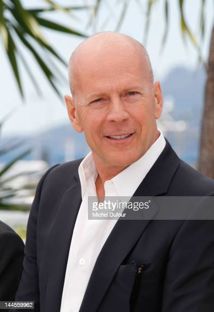 Bruce Willis poses at the 'Moonrise Kingdom' photocall during the 65th Annual Cannes Film Festival at Palais des Festivals on May 16 2012 in Cannes...