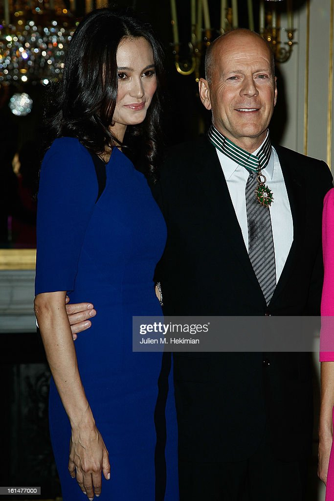 Bruce Willis poses with his wife Emma Heming-Willis after being awarded Commandeur dans l'Ordre des Arts et Lettres at Ministere de la Culture on February 11, 2013 in Paris, France.