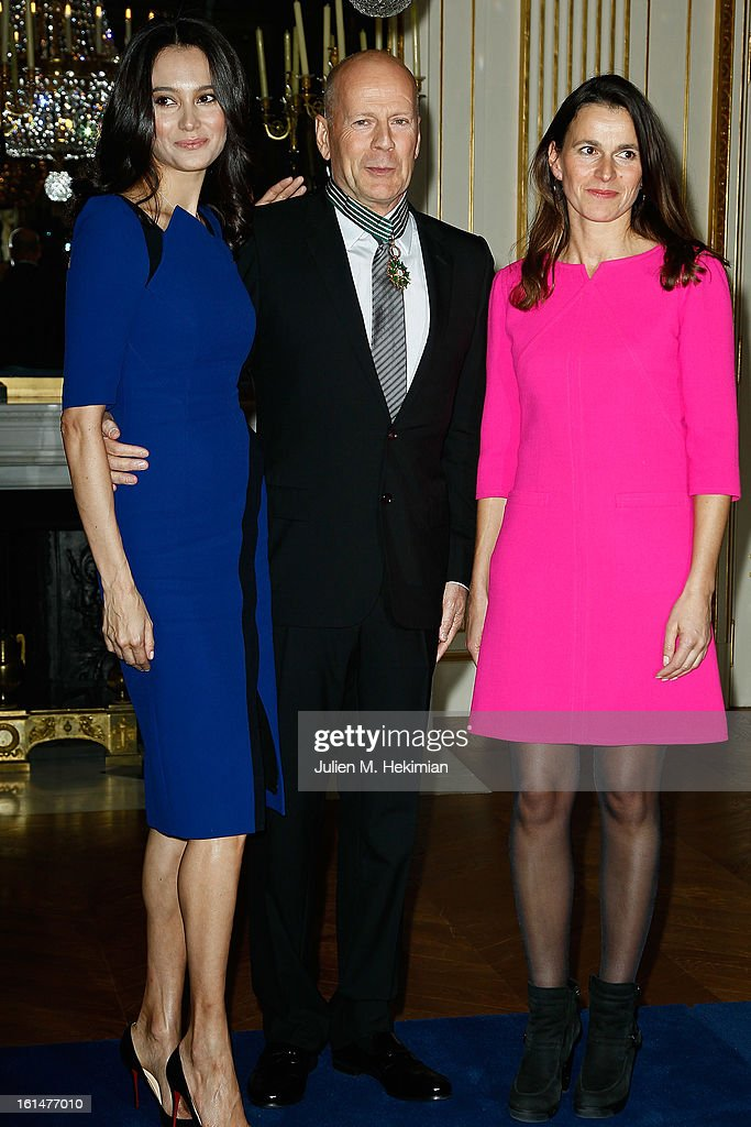 Bruce Willis poses with his wife Emma Heming-Willis after being awarded Commandeur dans l'Ordre des Arts et Lettres by French Minister for culture Aurelie Filippetti (R) at Ministere de la Culture on February 11, 2013 in Paris, France.