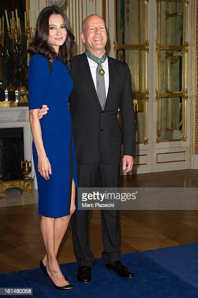 Bruce Willis poses with his wife Emma HemingWillis after being awarded 'Commandeur dans l'Ordre des Arts et Lettres' at Ministere de la Culture on...