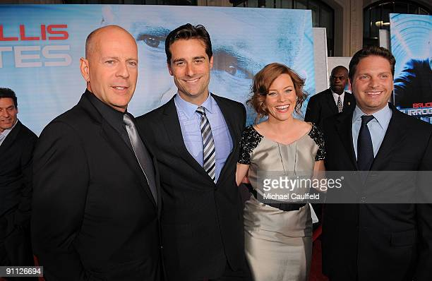 Bruce Willis producer Todd Lieberman Elizabeth Banks and producer Max Handelman arrive on the red carpet at the Los Angeles premiere of Surrogates at...